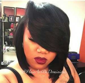 Bobcut with deep side part and bold red lipstick