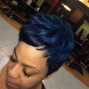 Pixie hair cut with blue hair