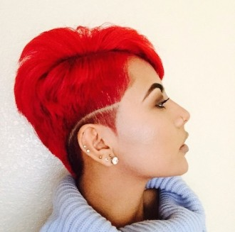 Tapered hair cut with red hair and defined part