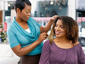 African American Hairstylist with her client