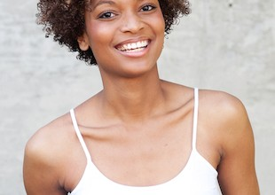 Woman wearing her natural hair standing outside after a big chop