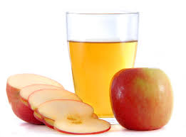 Picture of apples with glass of apple cider vinegar