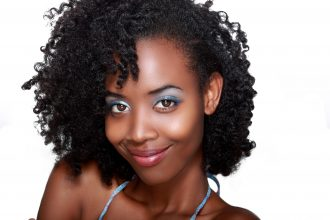 Smiling Black Woman with Moisturized Hair