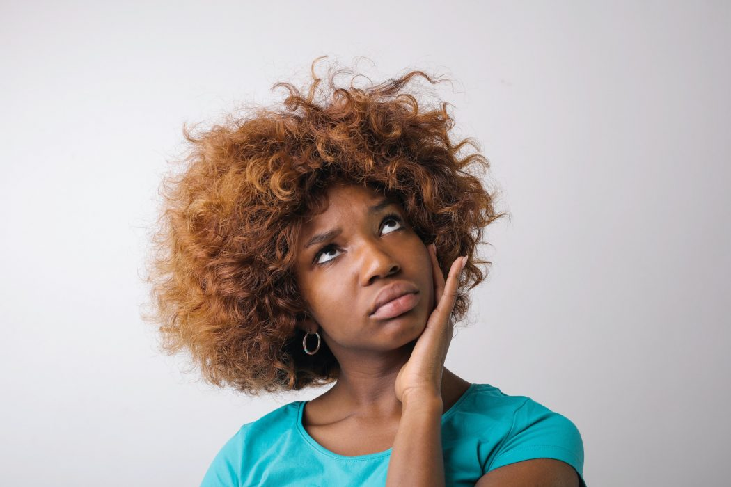 Black woman looking like she has a question